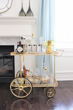 AM Dolce Vita: Vintage Bar Cart Styling, silver-rimmed numbered Tom Collins highball glasses, mid century mod silver rim glasses, vintage barware, brass pineapple ice bucket, Maison Bagues brass bar cart