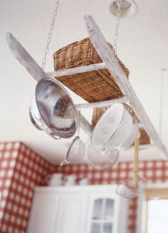 Why spend money on an expensive pot rack when an old white-washed ladder does the job and looks this cute?!? | 16 farm kitchen features we love | Living the Country Life | http://www.livingthecountrylife.com/homes-acreages/country-homes/16-farm-kitchen-features-we-love/