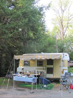 1966 Winnebago Travel Trailer with new awning, via Flickr.