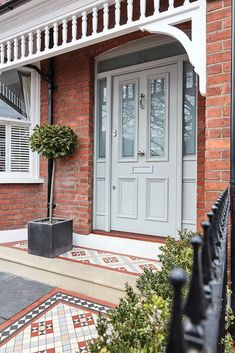 This classic Victorian style front door and door frame has etched glass panels, chrome door furniture and features a self-coloured letterbox. Front Door Porch, Porch Doors, Front Door Entrance, House Front Door, House Doors, House With Porch, House Entrance, Front Door Decor, Front Door Design