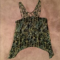 BCBG printed top BCBG printed top with green/yellow/black print. Lace collar. Loose fit on bottom, fitted on top. Play up for evening or down for day. Wear a blazer and make it work appropriate! Size XS. Worn once. BCBG Tops