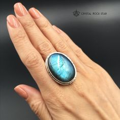 Imagine yourself rocking this large beautiful labradorite ring set in 925 sterling silver. Wear this magical flashy crystal as an everyday statement piece or as the ultimate accessory to an awesome outfit. The premium labradorite oval crystal in this ring features shades of blue and deep mermaid blue-green and has a gorgeous silver setting with some tribal detail lines.  Size 10