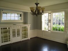 Traditional craftsman dining room. I love built in cabinets like that, especially glass fronted ones.