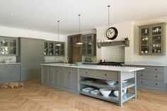 The amazing shaker style Queens Park Kitchen by deVOL complete with adorable lazy dog.