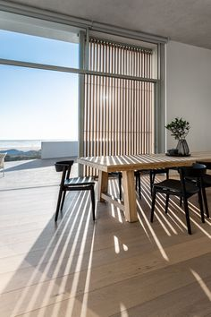 Strong geometry, clean lines and contemporary finishes help GSquared Architects redefine the traditional beach house vernacular with this home in Melkbos on Cape Town's West Coast. Bay House, Home, Outdoor Decor, Timber, Timber Staircase, Modern Light Fittings, House, Modern, Timber Screens