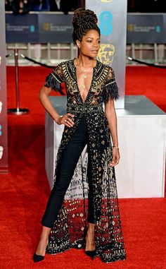 Glittering Gold from Fashion Police Naomie Harris pairs a beautiful embroidered black and gold Zuhair Murad ensemble with tailored black pants at the BAFTAs.