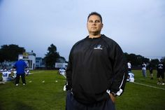 Centereach head football coach Adam Barrett poses on the field before the game at West Babylon on Oct. 10, 2014.