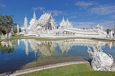 Wat Rong Khun, Chiang Rai, Thailand Artist Chalermchai Kositpipat began building the eccentric Wat Rong Khun, or White Temple, in his native Chiang Rai in Sacred Architecture, Amazing Architecture, Places Around The World, Around The Worlds, Beautiful Homes, Beautiful Places, Northern Thailand, World Photo, Buddhist Temple