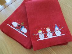 A pair of hand painted linen christmas napkins! A christmas present for my mother in law and partner. #lilykdesignscornwall #napkins #linen #handpainted #christmas