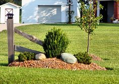 ideas for planting in front of a split rail fence | This simple landscaping looks great and all they did was add some ...