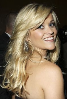 Curly Hairstyle with Side Swept Bangs; I just love Reese! I might get this cut