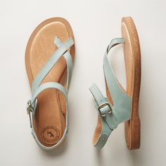 LYRIC SANDALS--Asymmetrical, supple leather straps give a carefree elegance to these lighthearted cork-soled leather sandals. Inset cork sole and padded insole for all-day comfort. Imported. Whole and half sizes 6 to 10, 11.