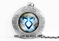 The Mortal Instruments locket necklace, City of Bones angelic power rune vintage glass stone locket necklace on Etsy, $4.99