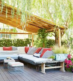 Even if you don't extend a true roof over your outdoor room, you can use similar lines, angles, and forms to provide shade. Here, wide-space beams, combined with the delicate fringe of a willow tree, create enough dappled shade to protect the restful seating area from direct rays.