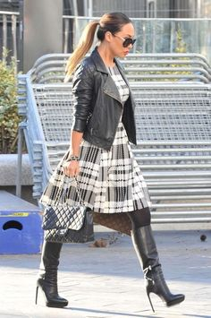 Myleene Klaas in a checked black and white dress with black leather biker jacket and high-heeled boots
