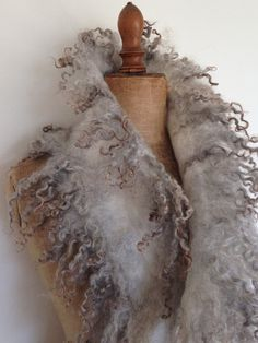 Wolwit made this exclusive nunofelted scarf by hand. Its very light, soft and delicate to wear. Looks lovely on your coat, daily dress or jeans. The faux fur scarf is made of chiffonsilk, merino wool and natural Gotland curly wool locks. Size 1.20 mtr x 36 cm. Weight: 94 gr.