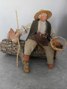 SANTON-DE-PROVENCE man sitting on log with basket