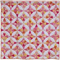 Pink and yellow, so pretty. And Kaleidoscope blocks can be paper pieced.