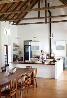 This beautiful Cape Dutch style farmhouse is idyllically situated near Hermanus, South Africa. It is home to a young family of four and a boutique wine label. On the outside you see a beautiful white,