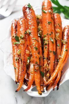 Honey garlic butter roasted carrots makes the perfect side for a weeknight meal or a holiday crowd. eatwell101.com