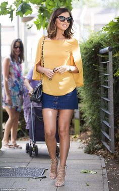 Seventies chick: The former TOWIE star looked summer ready in a billowing mustard-toned blouser, which featured pretty cape-style arms