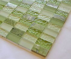 I am about to take on a DIY project !! I'm going to put up a glass tile backsplash in my kitchen. But first the hard part--picking the perfect tile. I do know it must have some green in it!