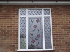 Casement windows with flower pattern engraving. http://www.finesse-windows.co.uk/casement_windows.php