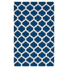Wool flatweave rug in midnight blue with a quatrefoil motif. Handmade in India.   Product: RugConstruction Material:...
