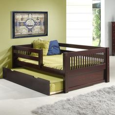 Make your little one feel bigger in his Isabelle Twin Size Day Bed. It features front and rear safety guard rails for extra security and peace of mind for you. Constructed entirely of solid wood, this bed includes a slat roll foundation, featuring unique super durable center rail support system, guaranteeing that this bed is built to last. This trundle provides a second bedding option. This modesty panels are included to complete the elegant look. The timeless Mission Style and the…