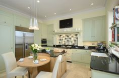 Bespoke Kitchen by Secret Drawer painted in Farrow & Ball's Cooking Apple Green