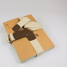 Book Strap in Cream made from Cotton and Washable Kraft Paper. $38.00, via Etsy.