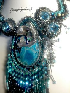 https://www.etsy.com/shop/LynnParpard?ref=listing-shop-header-item-count One of a Kind Art Piece made one bead at a time....... Could be Yours