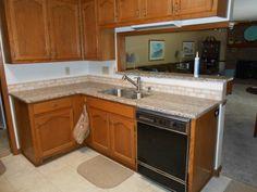 CREME CARAMEL Granite 60/40  sink Half Bull-nose edge 2x4 Light Travertine  Medium kitchen cabinets Visit us at http://www.fireplacecarolina.com  To See Our GRANITE COUNTERTOP PACKAGE DEAL   http://youtu.be/bemTgfKenwI