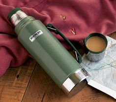 Nothing says hot coffee better than a Stanley Thermos. The iconic green thermos keeps your Folgers hot for the fishing trip or your Kenyan roast steaming all day in the office. Classic design and rugged dependability. Christmas Gifts For Men, Holiday Gifts, Hot Coffee, Coffee Time, Stanley Thermos, Coffee Thermos, Art Of Manliness, Holiday Gift Guide, Improve Yourself