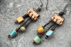 messy head messy beads messy wires........ stoneware beads, polymer clay beads, annealed steel wire, copper ear wire. €26.00, via Etsy.