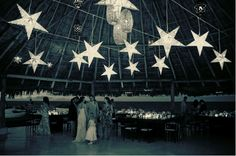 To finish a themed wedding, hang white star lanterns from the rafters of your marquee or barn!