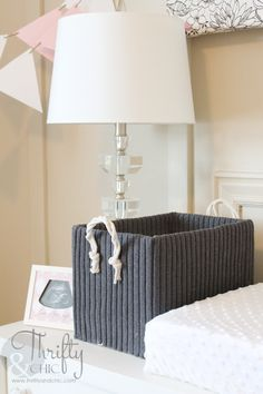 Cute storage boxes made from old boxes and sweaters!
