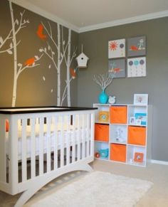 Bright accents and decals bring the dark gray walls and plain white furniture of this nursery to life. As seen in Design Dazzle.
