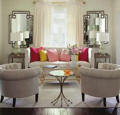 hollywood regency living room with brass coffee table & mirrors