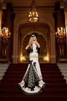 black and white wedding dress. I love the bustle and lace up corset top (wonder what the front looks like...)