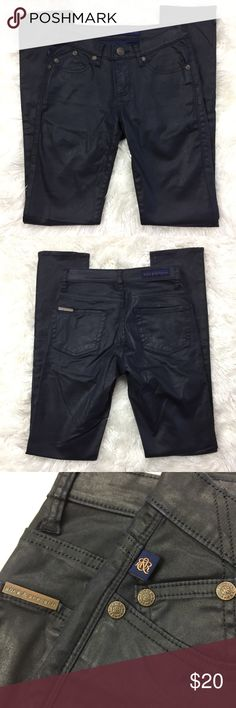 ROCK & REPUBLIC Berlin Jeans These pants are in great condition! No marks. 98% cotton 2% spandex. These pants are a navy color. Shiny fabric. 13 3/4 inches across the waist. 8 inch rise. 32 inch inseam. Non-smoking pet free home.                                                 🔹suggested user 🔹fast shipper🔹                                  🔸bundle to save 15%🔸300+ items🔸 Rock & Republic Jeans Skinny