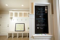 Mudroom- spot for everyone in the family and chalkboard (really a dry erase board so less dusty:) by Siena Custom Builders