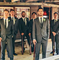 Baseball themed wedding groomsmen with custom engraved Louisville Slugger baseball bats ... order yours today www.SportsThemedWeddings.com