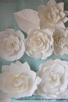 large chanel paper flower wall inspired wedding backdrop wall for world of posh NY | Paper Flowers Tutorials by Maria Noble