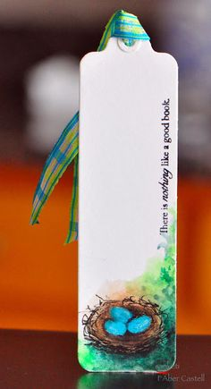 """""""There is nothing like a good book."""" (The Storyteller) The artist used  Faber Castell watercolor and Pastel pencils to create this charming bookmark."""