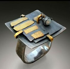 """One-of-a-kind ring by celebrated jewelry designer, Patricia McCleery.    Sterling silver and 22K gold, and moving opal element.    1"""" square"""