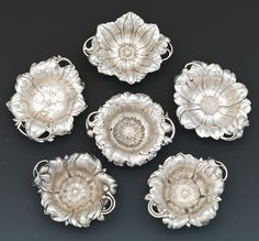 Set of Six Sterling Silver Floral Nut Dishes by Reed & Barton, dated 1903 -  Orchid, Cineraria, Clematis, two of Wild Rose and Poppy