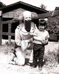 Yet one more reason I hate clowns...the stuff nightmares are made of...how is it that the girl is smiling?!