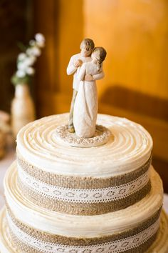 rustic wedding cake. I like the willow tree figurines as a cake topper!