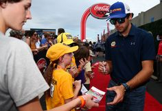 Chase Elliott Photos Photos - Chase Elliott, driver of the #24 NAPA Chevrolet, signs autographs during the driver and crew chief meeting before the Monster Energy NASCAR Cup Series Coca-Cola 600 at Charlotte Motor Speedway on May 28, 2017 in Charlotte, North Carolina. - Monster Energy NASCAR Cup Series Coca-Cola 600